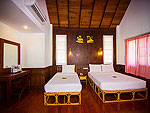 Bed Room : Deluxe Bungalow at Coco Palm Beach Resort, Maenam Beach, Samui