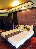 プーケット ヴィラコテージのホテル : カオラック パーム ビーチ リゾート(Khaolak Palm Beach Resort)のデラックス ガーデンルームの設備 Bedroom